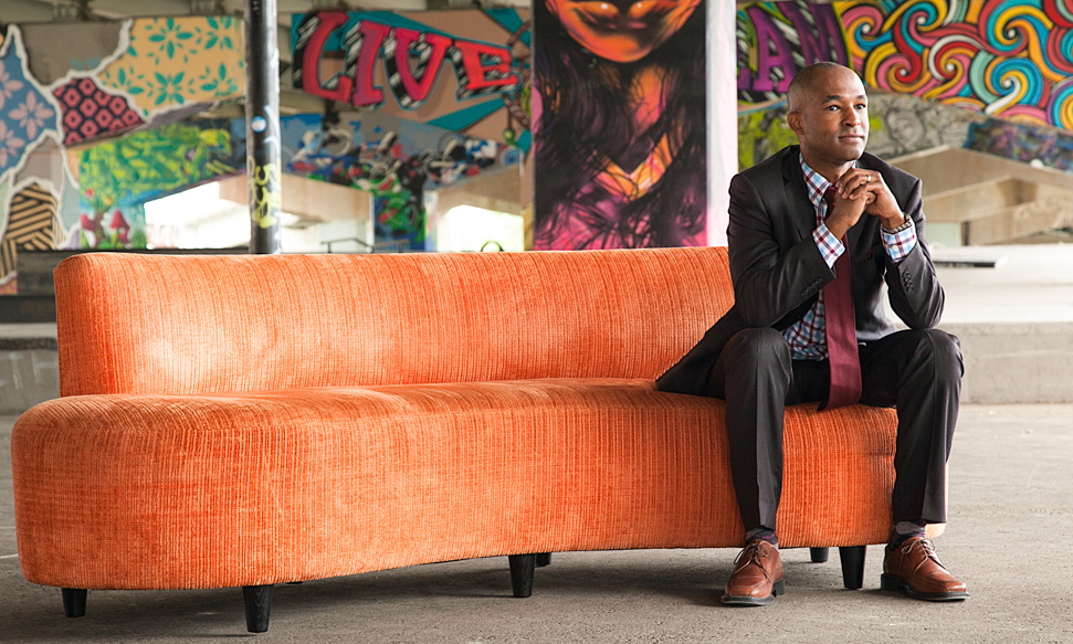 orange couch with business man outside corporate photography toronto 6164