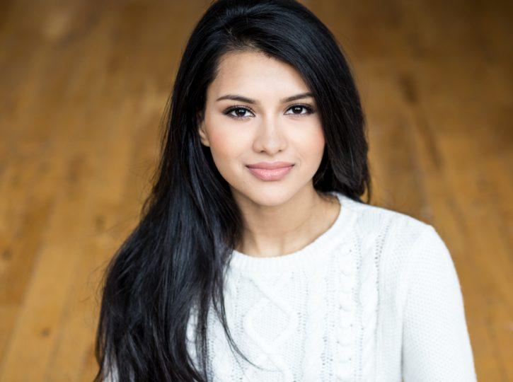 female in studio with wooden floor background actor headshots Toronto 2027