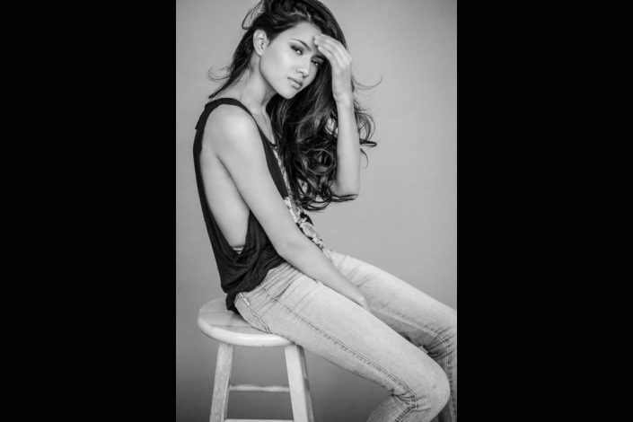 Jennifer sits on wooden stool portrait photographers Toronto 9361
