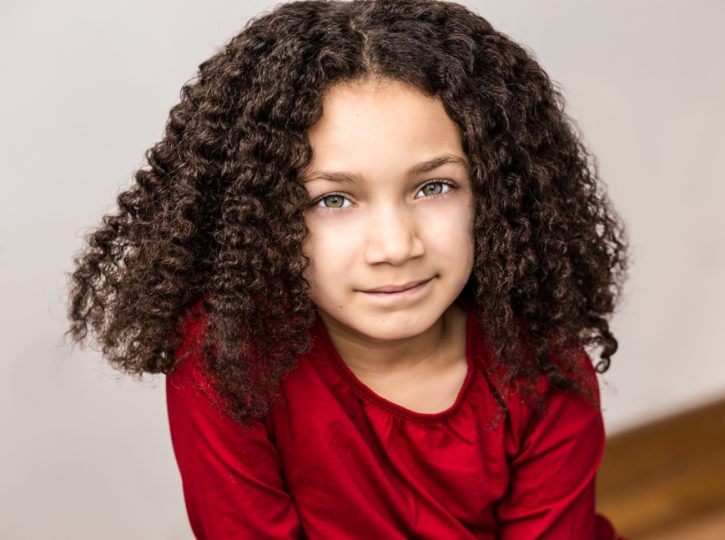 female child actor in bright red top for children's headshots Toronto 5594