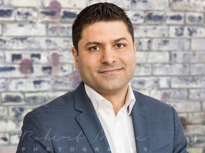 Mustafa brickwall backdrop LinkedIn headshot Toronto 2540
