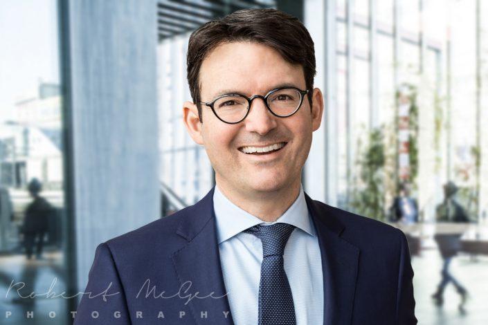 Carl smiling wearing blue suit professional photographer Toronto 8216