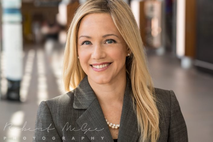 smiling executive in grey jacket for professional headshots Toronto 0O7C2608