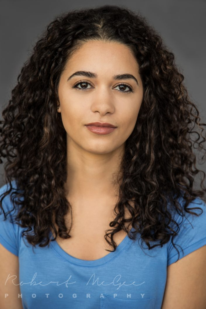 Maia with long curly hair wearing blue top for actor headshots Toronto 0O7C6318