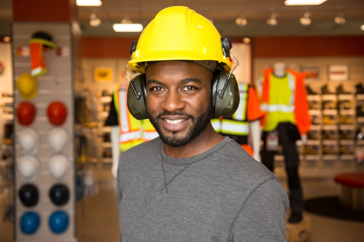 man in hard hat with earmuffs Mister Safety Shoes branding photography 0O7C4157