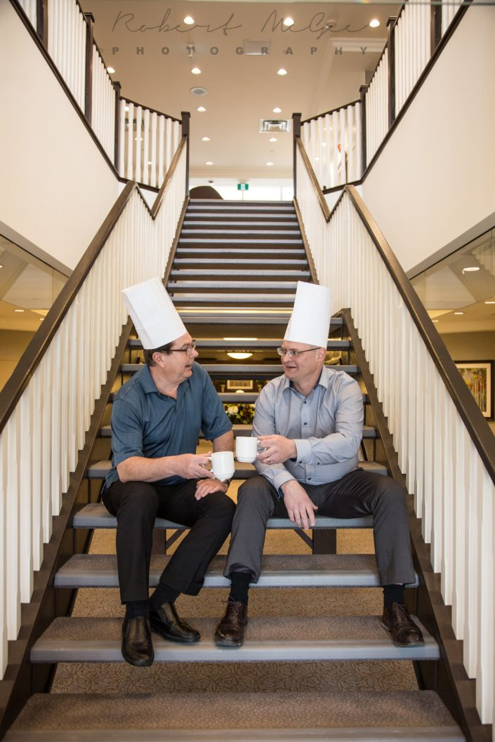 chefs drinking coffee on the stairs for branding photography Toronto 0O7C7174
