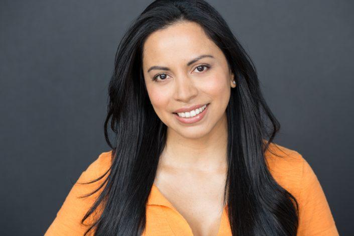 Elizabeth with long black hair and orange top female actor headshot 0O7C7478