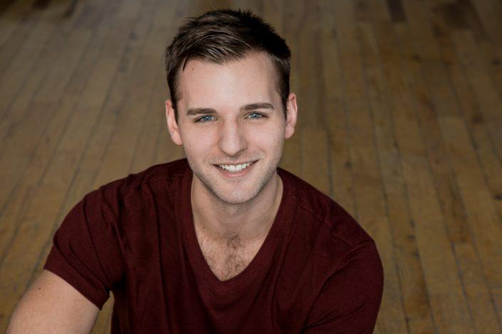 Joseph smiling wearing burgundy shirt for actor headshots Toronto 0O7C6942