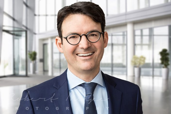 Carl with glass building foyer backdrop for business headshots Toronto 0O7C