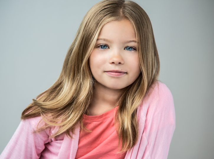 long blonde hair and a pink sweater for children's actor headshots Toronto 0O7C6885