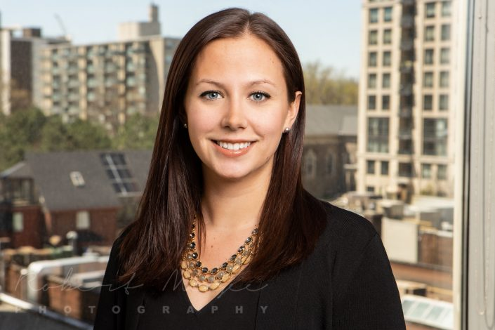 professional business headshot with Toronto city view through window 0O7C5252