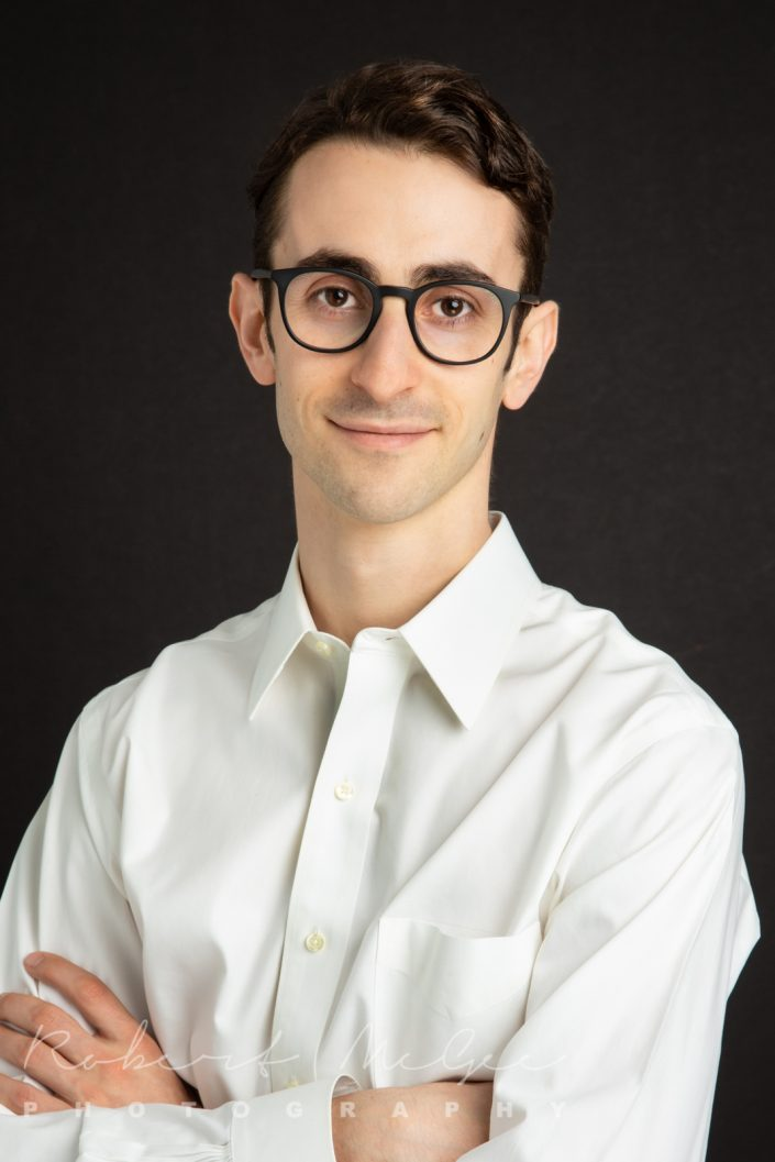 linkedin headshot for Bram wearing glasses and white shirt 0O7C1563