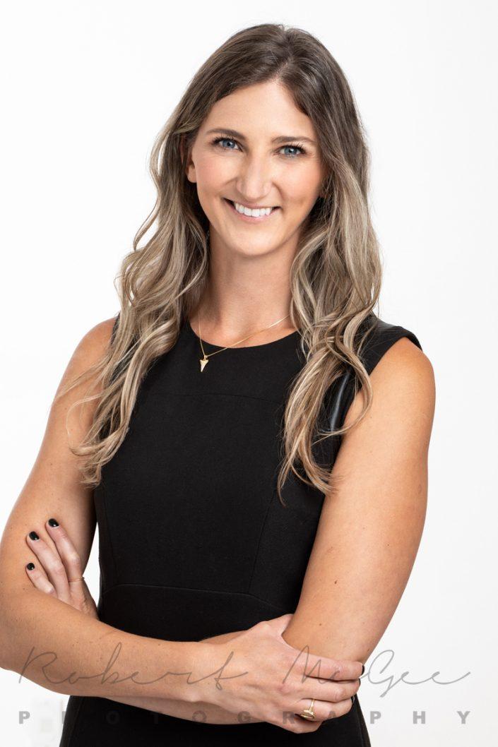 Lawyer Mackenzie in black dress for professional headshots Toronto 019A6775