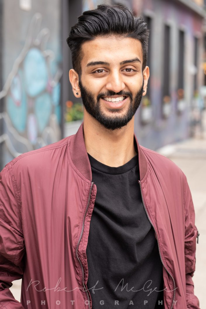 Yuvraj outdoors actor headshot maroon jacket 019A0763